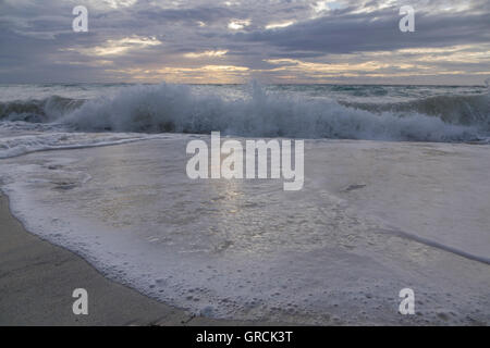 Splashing Waves Rolling On Sandy Beach - Stock Photo