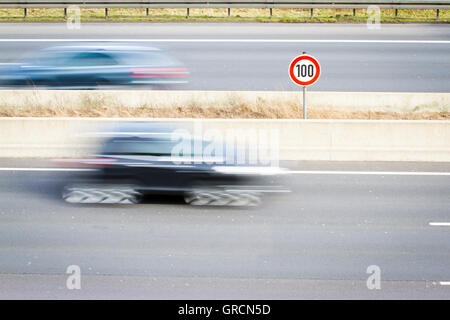 Sign Speed Limit On Highway Passing Traffic - Stock Photo