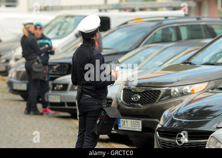 Meter Maids Issuing Tickets For Parking Violation Near Oktoberfest In Munich - Stock Photo