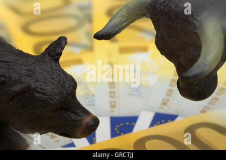 Bull And Bear With Euro Bills - Stock Photo