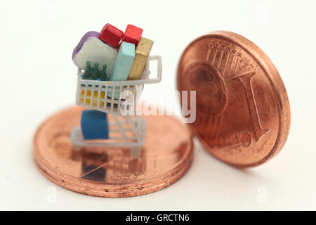 Full Shopping Cart On One And Two Euro Cent Coins - Stock Photo