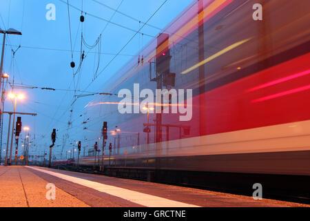 Regional Commuter Train Leaving Frankfurt Central Railway Station At Dusk - Stock Photo