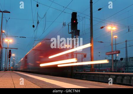 Regional Commuter Trainarriving Frankfurt Central Railway Station At Dusk - Stock Photo