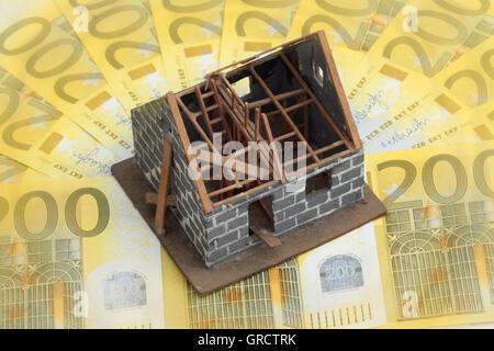Miniature House Under Construction On Euro Bills - Stock Photo