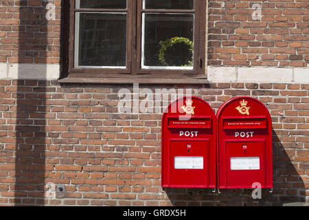 Two Red Mail Boxes On Brick Wall Of A House In Stege Denmark - Stock Photo