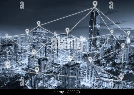 Bangkok night view in business district with map pin flat network above Bangkok city with network connection concept - Stock Photo
