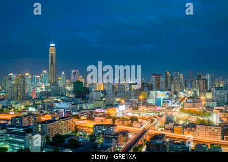 Bangkok city skyline and Bangkok skyscrapers building at night in Bangkok city, Thailand. - Stock Photo