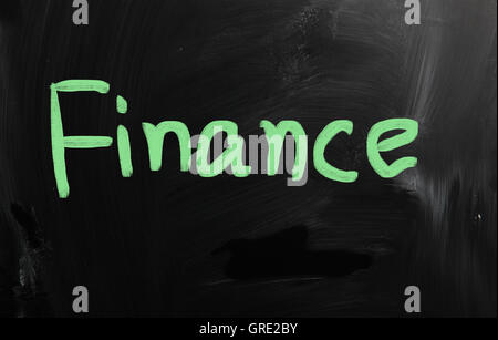 Finance handwritten with white chalk on a blackboard - Stock Photo