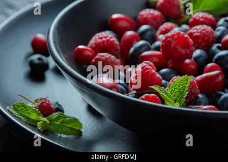 Fresh berries in the bowl. - Stock Photo