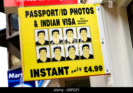 passport id photos & indian visa sign outside shop in norfolk, england - Stock Photo