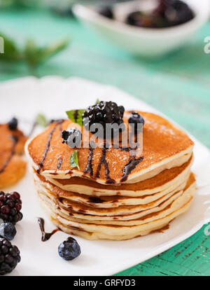 Delicious pancakes with blackberries and chocolate. - Stock Photo