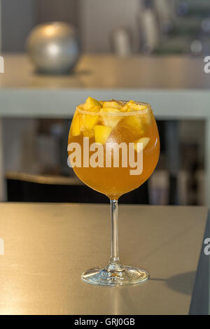 orange, apple and white wine cocktail over the table - Stock Photo