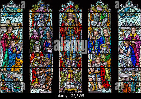 Stained glass window depicting 'Christ in Glory with Saints and Angels', Church of St. David, Nefyn, Gwynedd, Wales - Stock Photo