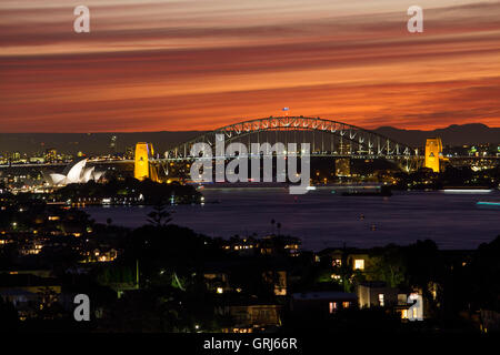 Sydney Harbour Bridge and Opera House at sunset night twilight from Dudley Page Reserve Sydney New South Wales NSW - Stock Photo