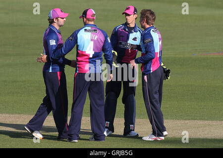 Middlesex players celebrate the wicket of Mark Pettini - Essex CCC vs Middlesex CCC - Friendly Cricket Match at - Stock Photo
