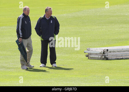 Umpires Nigel Cowley (R) and Steve Gale inspect the outfield - Essex CCC vs Northamptonshire CCC - LV County Championship - Stock Photo