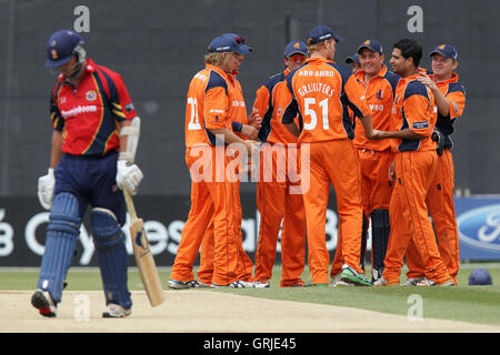 Netherlands players celebrate the wicket of Mark Pettini - Essex Eagles vs Netherlands - Clydesdale Bank 40 Cricket - Stock Photo