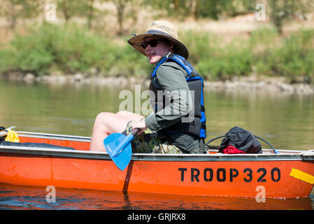 A Boy Scout paddles his canoe down the Clearwater River near Orofino, Idaho while traveling on the original Lewis - Stock Photo