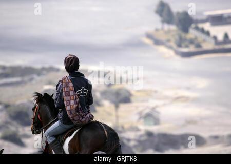 Indonesia, Java, East Java Province, Bromo Tengger Semeru National Park, horsemen bring tourist on top of Gunung - Stock Photo