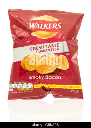 Winneconne, WI - 12 August 2016: Bag of Walkers chips in smokey bacon flavor on an isolated background. - Stock Photo