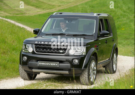 A Landrover Discovery driving off road at an event on the Yorkshire Wolds in rural East Yorkshire - Stock Photo