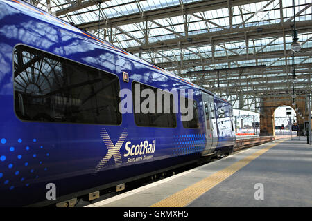 GLASGOW, SCOTLAND, UK - JULY 12, 2013: A ScotRail train at the platform at Queen Street station in Glasgow. - Stock Photo