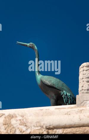 Bronze Crane at Forbidden City in Beijing, China - Stock Photo