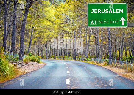 JERUSALEM road sign against clear blue sky - Stock Photo