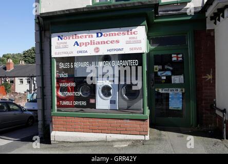 Corner shop selling washing machines - Stock Photo
