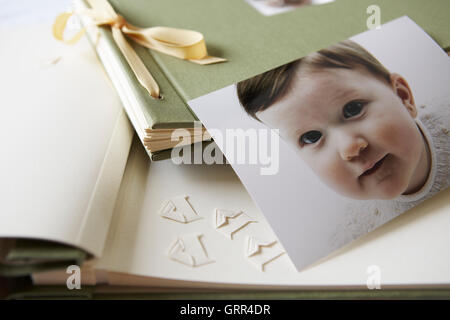 Photo album, scrap book with baby photograph - Stock Photo