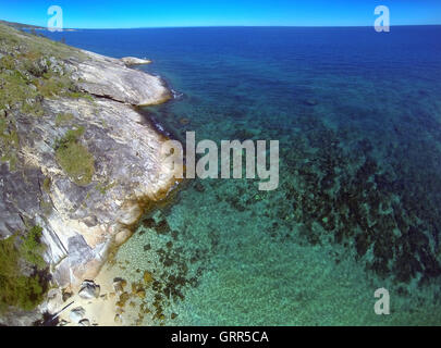 Aerial view of fringing reef of Lizard Island with patchy pale bleaching of corals, Great Barrier Reef, Queensland, - Stock Photo