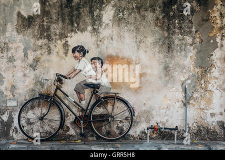 George Town, Malaysia - March 21, 2016: Famous creative Penang street art on the wall of UNESCO Heritage Buffer - Stock Photo