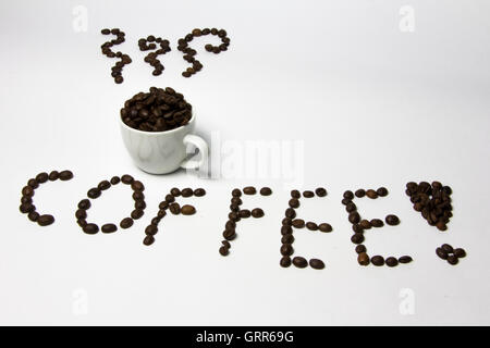 Coffee cup with steam and word COFFEE made from coffee beans. Creative, original. - Stock Photo
