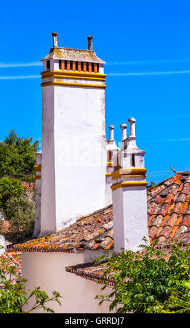 Towers Chimneys Orange Roofs Medieval Town Obidos Portugal. Castle and walls built in 11th century after town taken - Stock Photo