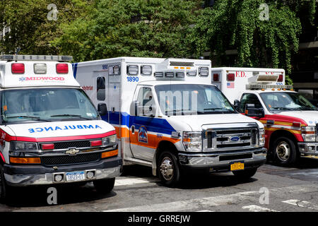 3 different ambulances wait at a set of Traffic Lights in New York - Stock Photo