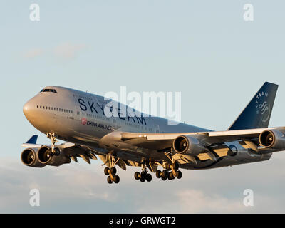 A Boeing 747-400 B-18211 painted in special SkyTeam livery and belonging to China Airlines on final approach for landing