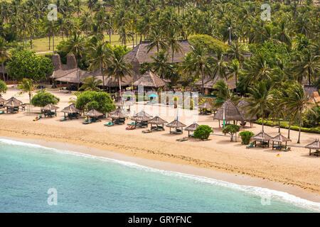 Tropical resort on Kuta sand beach, Lombok, Indonesia - Stock Photo