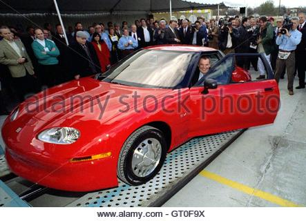 a general motors ev1 electric car has its battery recharged at a stock photo royalty free image. Black Bedroom Furniture Sets. Home Design Ideas