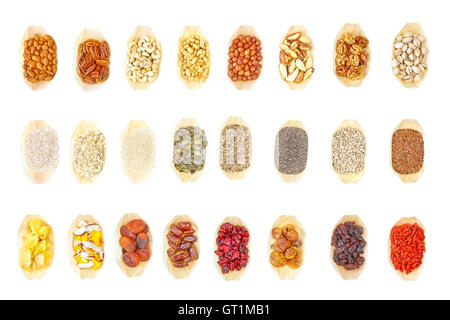 Super food selection in wooden bowls on white background, view from above. - Stock Photo