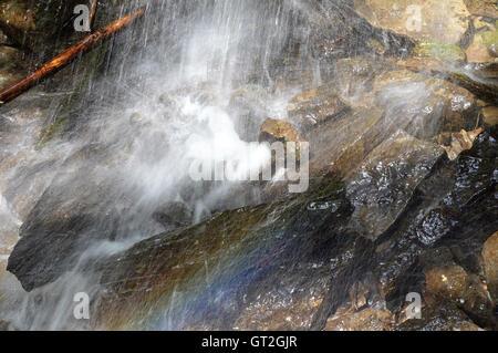 Rainbow in the Splashing Water - Stock Photo