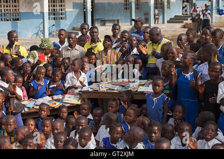 Donation of reading books to primary school, supported by iron ore mine in the district with head master, teachers, - Stock Photo