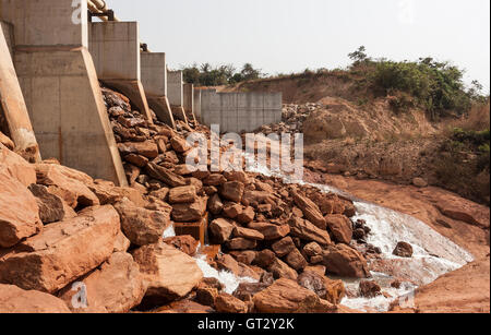 Mining operations for producing and managing iron ore. Newly built dam and weir providing new water resource for - Stock Photo