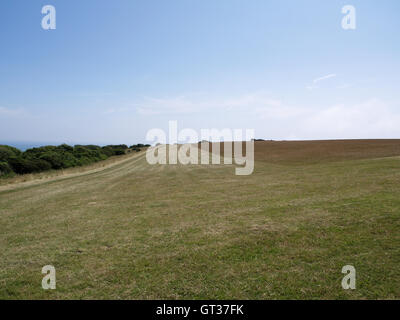 Mowed field of grass off Beachy Head Way, Eastbourne, East Sussex overlooking English Channel - Stock Photo