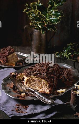 Sliced christmas chocolate yule log - Stock Photo