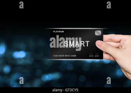 hand picking smart platinum card on blur background - Stock Photo