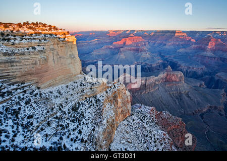 Snow-covered bluffs and canyons, from Maricopa Point, Grand Canyon National Park, Arizona USA - Stock Photo