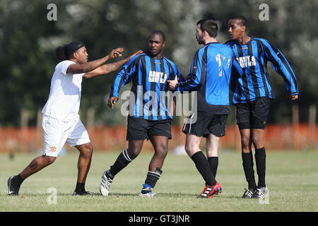 Trouble flares and a player is sent off - Army & Navy (black/blue stripes) vs Hackney Borough (light blue) - Hackney - Stock Photo