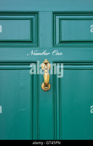 Green Wooden Paneled Front Door No 95 With Brass Knocker