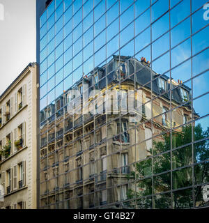 Typical French apartment building architecture in Paris - Stock Photo