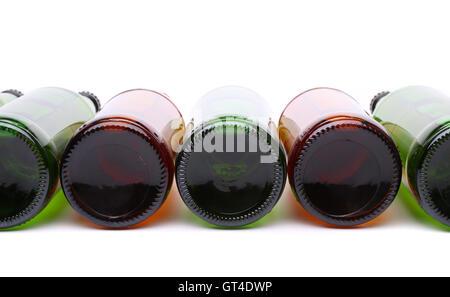 Bottles lying in row. The bottoms of bottles. - Stock Photo